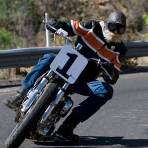 don robertson riding his flat track harley davidson through a hairpin turn on highway 89a above jerome arizona