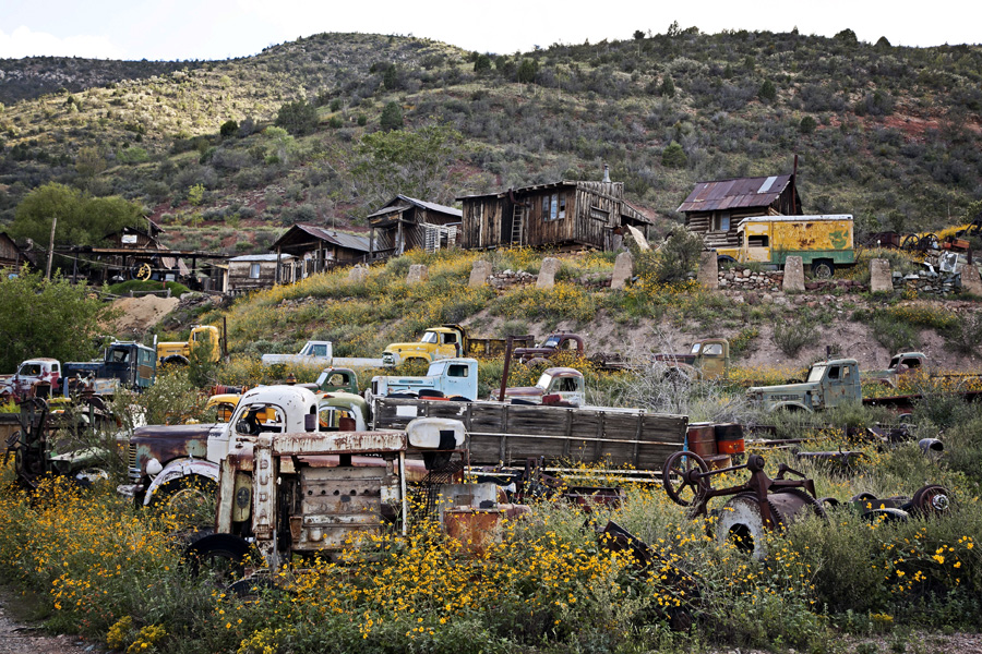 working sawmill, old wooden buildings, old trucks and wildflowers