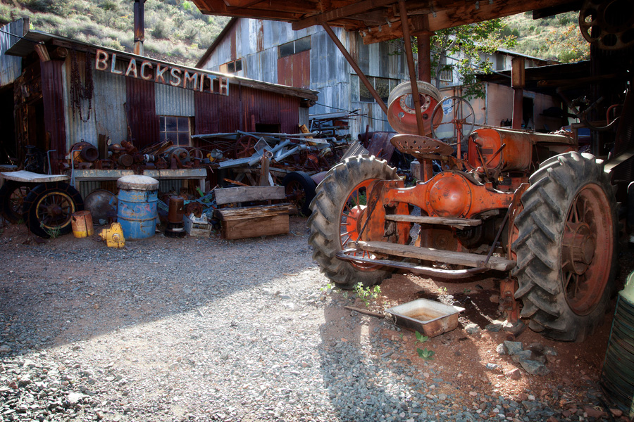 blacksmith shop exterior with old tractor used to start big bertha