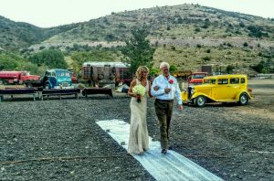 the father escorts the bride at the gold king mine and ghost town in jerome arizona